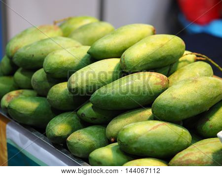 Green mango pile - fruit, dieting clean food, Organic  fruit sale in market