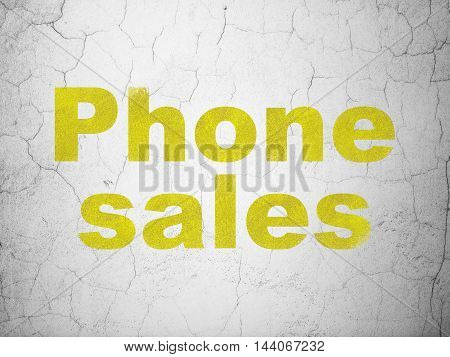 Advertising concept: Yellow Phone Sales on textured concrete wall background
