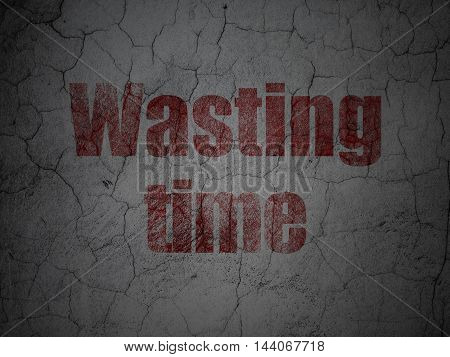 Time concept: Red Wasting Time on grunge textured concrete wall background