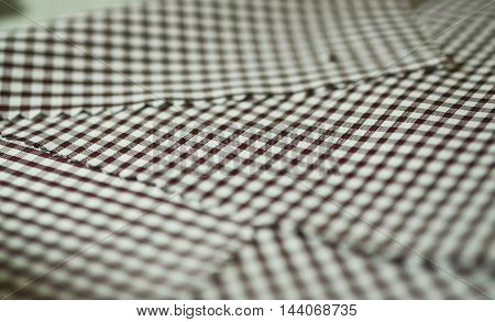close up texture brown scott pattern fabric of shirt photo shoot by depth of field for object