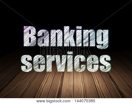 Money concept: Glowing text Banking Services in grunge dark room with Wooden Floor, black background