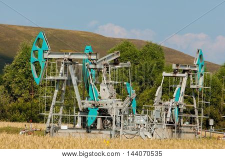 Oil Pump. Oil Industry Equipment. Filtered Picture Of Oil Pump Jack,