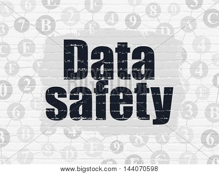 Information concept: Painted black text Data Safety on White Brick wall background with Scheme Of Hexadecimal Code