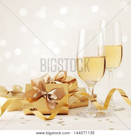 two champagne glasses and gift boxes