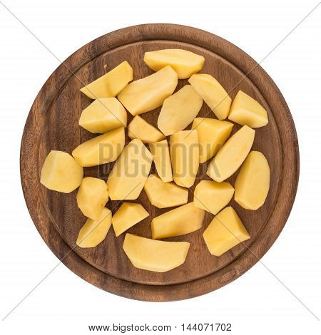 Sliced peeled raw potatoes on a board. Top view.