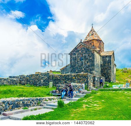 SEVAN ARMENIA - MAY 31 2016: The local painters offers their works next to the Holy Apostles Church of Sevanavank Monastery on May 31 in Sevan