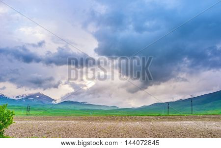 The peaks of the mountains are hidden in hard clouds Syunik Province Armenia.