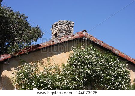 This is an image of an old California Mission taken under clear blue sky on a sunny day.