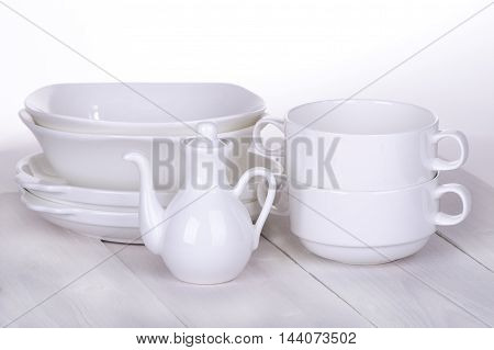 White crockery on a white wooden table
