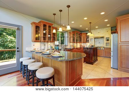Luxury Kitchen Room Interior With Cabinets And Granite Counter Tops