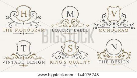 Retro Royal Vintage Shields Logotype set. Vector calligraphyc Luxury logo design elements. Business signs, logos, identity, spa, hotels, badges elements