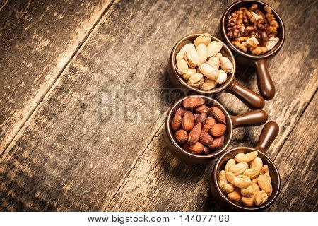 Mix Nuts On Wooden Table,healthy Vegan Food.