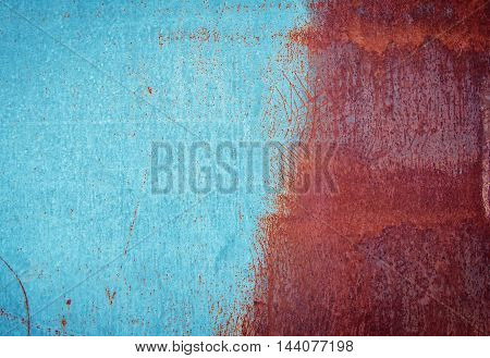 Half painted blue rusty scratched dirty metal texture, grunge background
