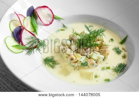 White plate with cold summer soup