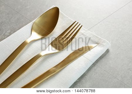 Table setting with cutlery and napkin, closeup