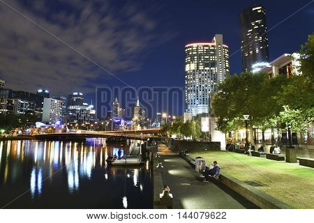Melbourne's popular Southbank precinct and Yarra River at night.