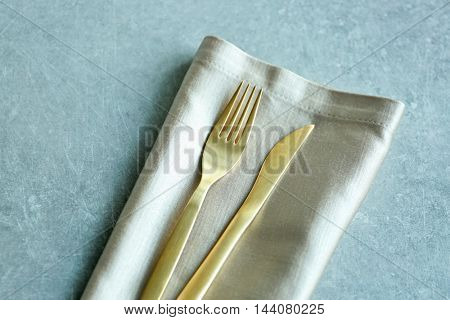 Table setting with fork, knife and napkin, closeup