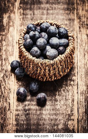 Berries In Basket On Wooden Vintage Table,healthy Food.