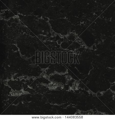 Pattern of black marble texture. Closeup stone surface natural abstract background.