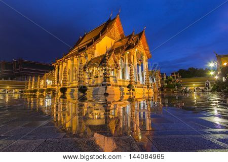 Temple in bangkok wat suthat at twilight time and reflection later raining Thailand
