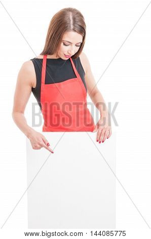 Young Employee With Apron Pointing At Cardboard