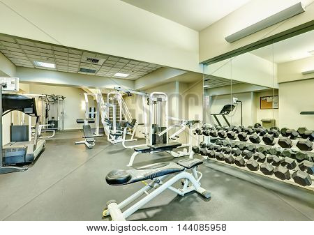 Interior Of New Modern Gym With Sport Equipment