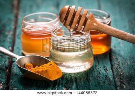 Honey And Turmeric On Wooden Table.healthy Food