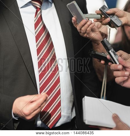 media interview, toned image, close up, unrecognizable people