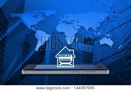 Hammer and wrench with house icon on modern smart phone screen over map and city tower background Home service concept Elements of this image furnished by NASA