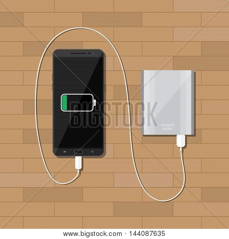 Silver powerbank charging a black smartphone on wooden desk. vector illustration in flat style