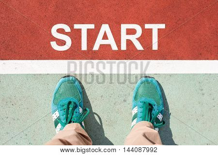 Top view of foot on the trail with the word START for the concept of starting point