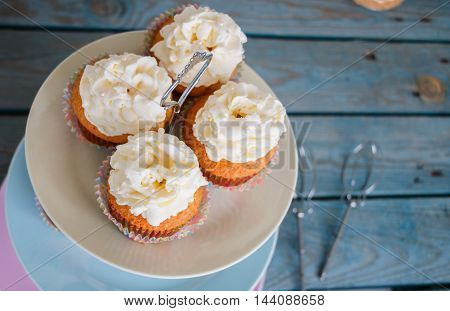 Cupcakes on the colorful three storey plate