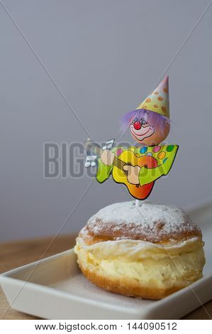 doughnut decorated with figure with vanilla cream