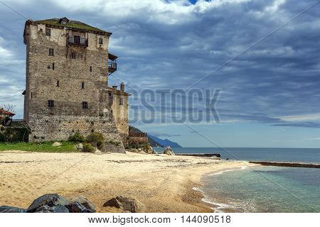 Seascape with Medieval tower in  Ouranopoli, Athos, Chalkidiki, Central Macedonia, Greece