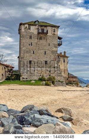 Beach and Medieval tower in  Ouranopoli, Athos, Chalkidiki, Central Macedonia, Greece