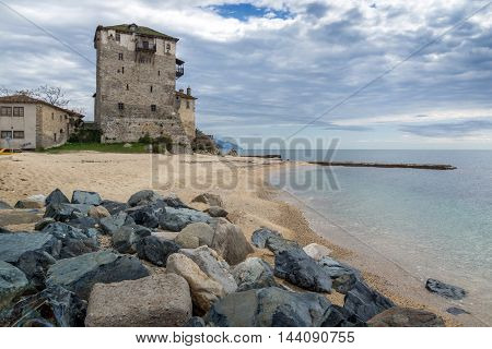 Stones Medieval tower in  Ouranopoli, Athos, Chalkidiki, Central Macedonia, Greece