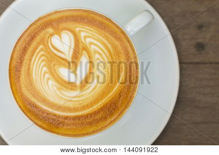 Latte Coffee art on the wooden table