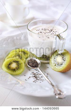 Healthy breakfast: yogurt kiwi and Chia seeds. Focus selective