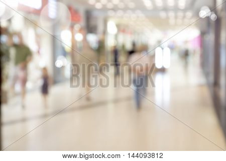 Blur store with bokeh background. Silhouettes of Business People in Blurred Motion Walking. Business people walking in the office corridor.