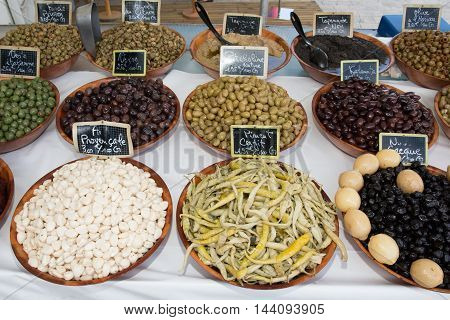 Various Kinds Of Olives, Chili And Garlic At French Market
