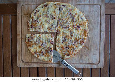 Rustic Stone Backed Pizza With Chorizo Salami Flat Lay