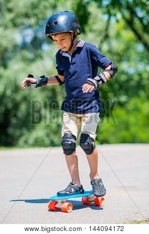 Little boy with skateboard, toned vertical image,