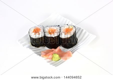 sushi pieces on white plate