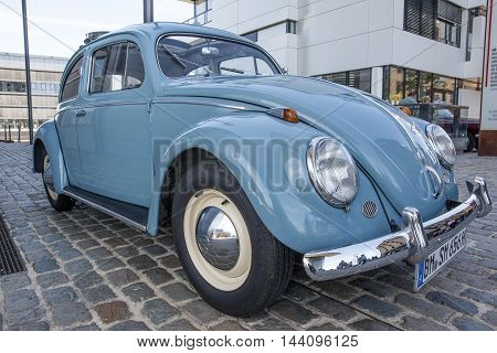 COLOGNE GERMANY - AUG 7 2016: Historic Volkswagen Beetle at an exhibition in the city of Cologne Germany