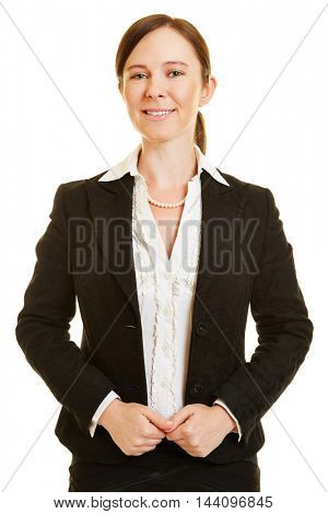 Front view of smiling business woman pulling her jacket straight