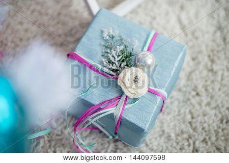 beautiful decorative Christmas present under the Christmas tree