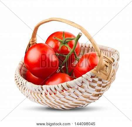 front view of a bunch of tomatoes in a wood basket isolated on white