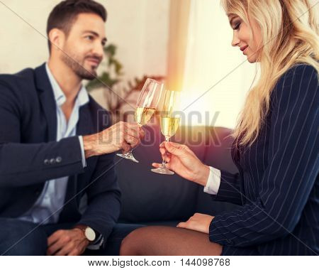 Business people toast in office young businessman and businesswoman business meeting