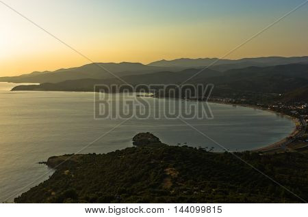 Sunset at Toroni bay, aerial photo from the top of a hill, west coast of Sithonia, Greece