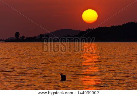 Sunset at Toroni bay, west coast of Sithonia, Greece